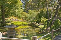 Japanese garden with Stone Lantern. And pond Stock Images