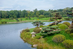 Japanese garden with stone lantern. By water Stock Photography