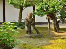 Japanese garden and sweeping statue, Kyoto Japan Royalty Free Stock Photography