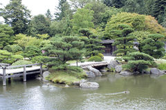 Japanese garden with a traditional gate Royalty Free Stock Photography