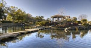 Japanese garden. Trees, bridges and pond in Japanese garden in Ochiai Park, Kasugai near Nagoya, Japan Stock Photo
