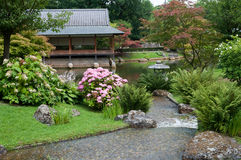 Japanese garden. A view of a Japanese garden with ceremonial house and pond Stock Photo