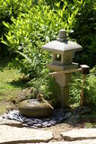 Japanese garden water feature and lantern. Japanese garden decoration of a lantern and water feature Stock Image