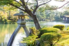Japanese garden and water pond. Beautiful outdoor scenery landscape Royalty Free Stock Photos