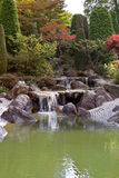 Japanese garden with a waterfall Stock Photos