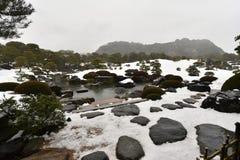 Japanese garden with white snow stock image