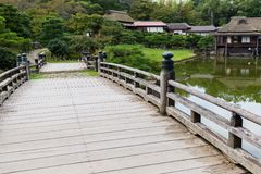 Japanese garden with wooden bridge. Outdoor beautiful scenery landscape stock photography