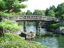 Japanese Garden. Wooden foot bridge in a Japanese garden Royalty Free Stock Image