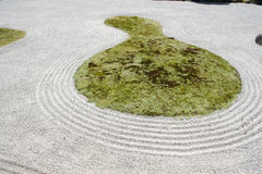 Japanese garden zen rock sand Stock Photo
