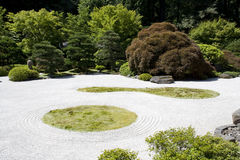 Japanese garden zen rock sand Royalty Free Stock Image