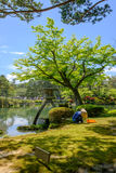 Japanese gardeners in Kanazawa, japan. Japanese gardeners near the Toro lantern in Kenrokuen, a japanese garden in Kanazawa, Ishikawa prefecture, Japan Stock Photography