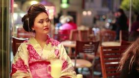 Japanese geisha at cafe stock video footage