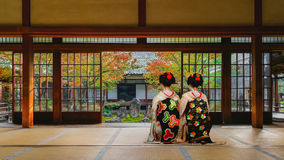 Japanese Geisha at in Colorful Autumn at Kenninji Temple in Kyoto Royalty Free Stock Photo