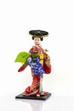 Japanese geisha dolls. Japanese geisha dolls with wisteria blossome on white background Stock Images