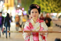 Japanese geisha samurai with sword outside at night Stock Images