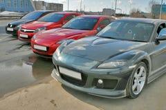 Japanese and german cars Stock Photos