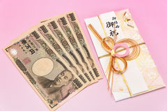 Japanese gift envelope and Ten thousand yen bill. Royalty Free Stock Photo