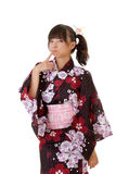 Japanese girl. Adorable Japanese girl with funny expression in traditional clothes Stock Image