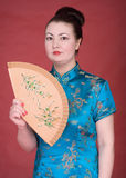 Japanese girl. With fan on the red background Stock Photos