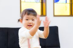 Japanese girl dancing with expressive hand movements in living room stock images
