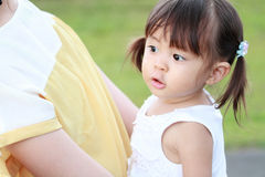 Japanese girl carried in her mother`s back. 1 year old Royalty Free Stock Image