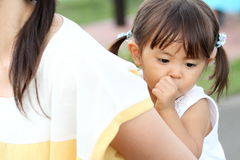 Japanese girl carried in her mother`s back Royalty Free Stock Photography