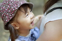 Japanese girl carried in her mother`s back. 2 years old Stock Photography