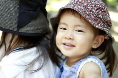 Japanese girl carried in her mother`s back. 2 years old Stock Images