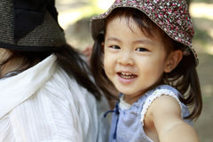 Japanese girl carried in her mother`s back. 2 years old Royalty Free Stock Photography