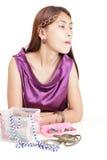 Japanese girl choosing jewelry Royalty Free Stock Photos
