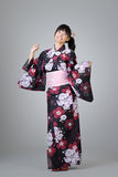 Japanese girl dancing. Happy smiling Japanese girl dancing in traditional clothing stock photography