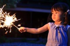 Japanese girl doing handheld fireworks Royalty Free Stock Photos