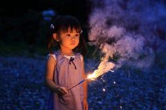 Japanese girl doing handheld fireworks Stock Photo
