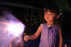 Japanese girl doing handheld fireworks Stock Photography