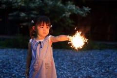 Japanese girl doing handheld fireworks Stock Image