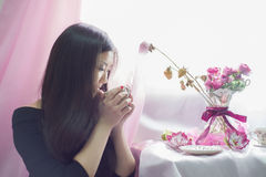 Japanese the girl is drinking tea. royalty free stock images