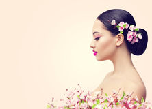 Japanese Girl and Flowers, Asian Woman Beauty Makeup Profile. Beautiful Fashion Model Side View over Pink Background royalty free stock image