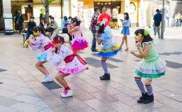 Japanese girl group performance. Tokyo, Japan - May 5, 2015: Young Japanese girl group performs a routine outside Akihabara station in Tokyo Royalty Free Stock Photos