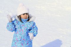 Japanese girl having snowball fight. 3 years old stock photo