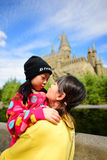 Japanese girl holding her sister. OSAKA, JAPAN - OCTOBER 13, 2016: Japanese girl holding her sister taking photo at The Hogwarts castle in The Wizarding World of Stock Photography