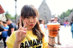 Japanese girl holding Plastic glass of Butter beer. OSAKA, JAPAN - OCTOBER 13, 2016: Japanese girl holding Plastic glass of Butter beer in Wizarding World of stock image