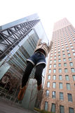 Japanese girl jumping in front of skyscrapers Stock Photos