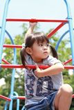 Japanese girl on the jungle gym. 3 years old stock photography