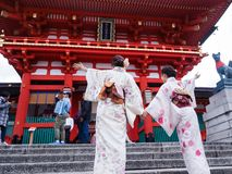 Japanese girl with Kimono happiness at Fushimi Inari Shrine. Royalty Free Stock Image