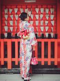 Japanese girl with Kimono happiness at Fushimi Inari Shrine. Stock Images