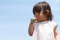 Japanese girl playing with bubble Royalty Free Stock Image