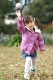 Japanese girl playing catch Stock Images