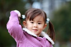 Japanese girl playing catch Royalty Free Stock Photography