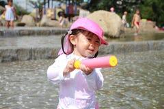 Japanese girl playing with water gun Stock Photos