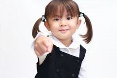 Japanese girl pointing at the camera in formal wear Royalty Free Stock Photo